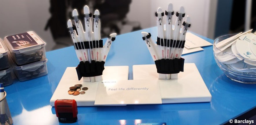 Photograph of Cambridge Simulation Gloves used on a Barclays workshop table
